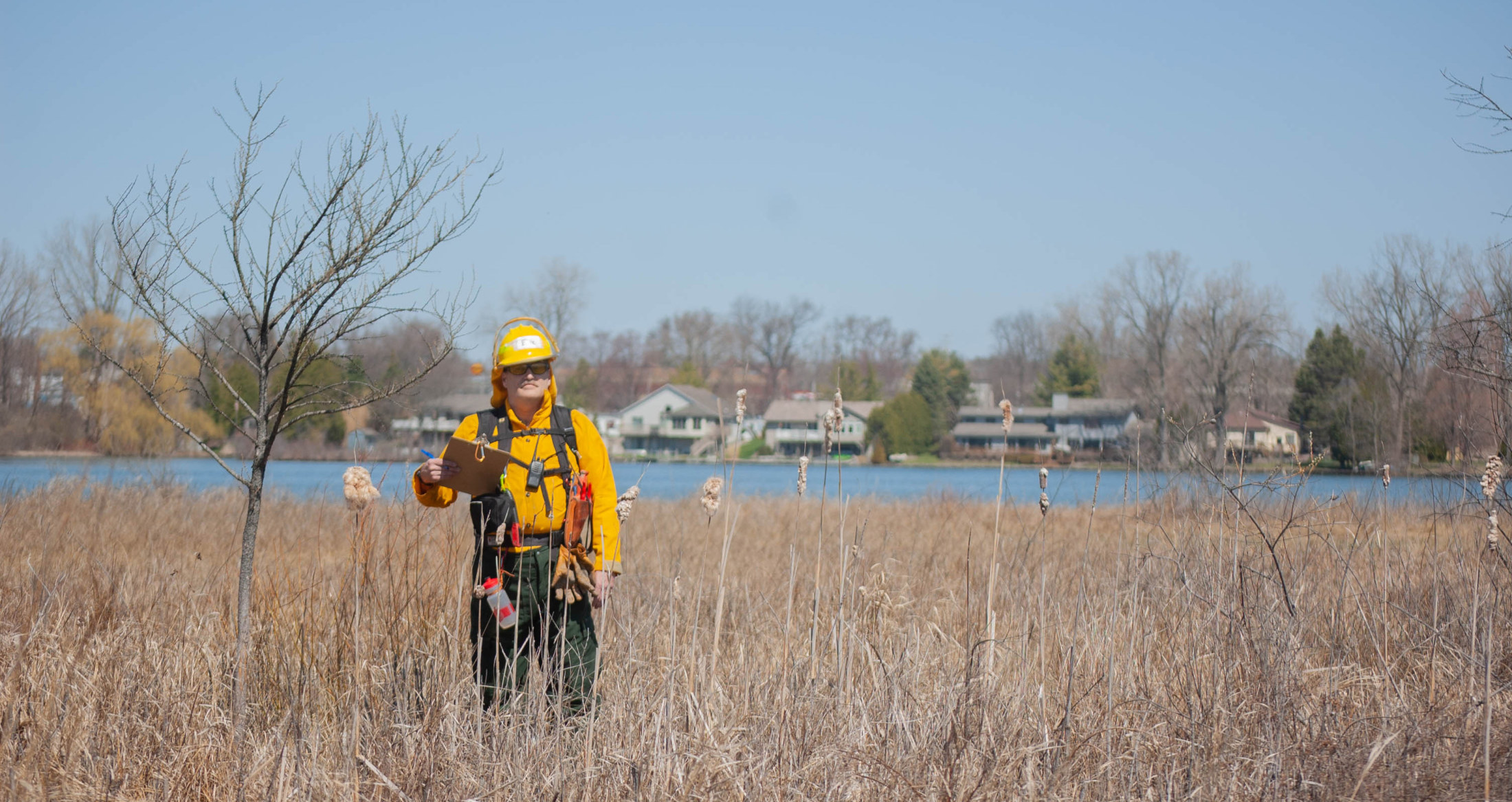 photo of author monitoring weather at a prescribed burn, select to visit website of organization for which author works prescribed burns
